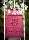 Post box with daily newspapers flying Royalty Free Stock Image