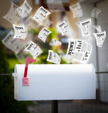 Post box with daily newspapers flying Royalty Free Stock Photo