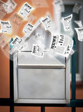 Post box with daily newspapers flying Stock Image