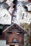 Post box with daily newspapers flying Stock Photo