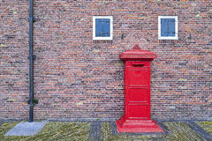 Post Box and Old Vintage Brick Wall Background Stock Images