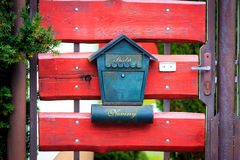 Post box on red wooden gate Royalty Free Stock Photos
