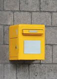 Post box. Small yellow post box on building wall outdoor Royalty Free Stock Photos