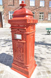 Post box in a street of Bruges (Belgium) Royalty Free Stock Photo