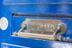 Post box vintage. On blue door, Porto, Portugal Stock Images