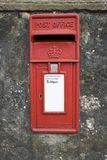 Post box in a wall. Red british old post box in a wall Stock Images