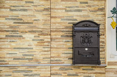 Post box on wall stone Stock Photography