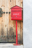 Post box with wood door Royalty Free Stock Images