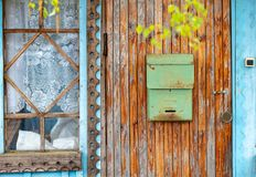 Post box on wooden door in Russia royalty free stock photo
