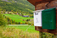 Post boxes with a Norwegian countryside. In the background Stock Photo