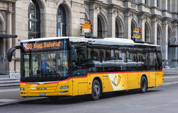 Post Bus in Winterthur, Switzerland. Winterthur, Switzerland - 26 December, 2016: a Post Bus at the Swiss Post office on Bahnhofplatz square. PostBus German Royalty Free Stock Images
