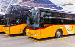 Post Buses at the bus station in the city of Chur in Switzerland Royalty Free Stock Photos