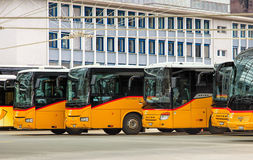 Post Buses at the bus station in the city of Chur in Switzerland Royalty Free Stock Images