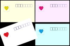 Post card and heart shaped sticker Royalty Free Stock Image