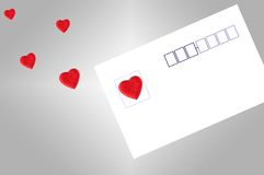 Post card and heart shaped sticker Royalty Free Stock Images