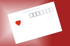 Post card and heart shaped sticker Royalty Free Stock Photos