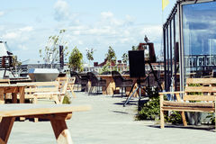 Post card view. empty summer roof top cafe, lot of tables Stock Images