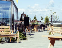 Post card view. empty summer roof top cafe, lot of tables Royalty Free Stock Images