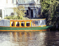 Post card view: vintage boat on canal in Amsterdam Netherlands Royalty Free Stock Image
