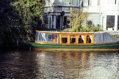 Post card view: vintage boat on canal in Amsterdam Netherlands Stock Photo
