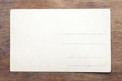 Post card on wood Royalty Free Stock Image