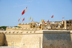 Post of Castile. Birgu. Malta. The view of Post of Castile with the flags flaping over the fortress walls for a holiday. Malta Royalty Free Stock Images