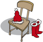 Post Christmas. Chair with Father Christmas hat and boots Stock Images