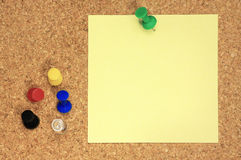 Post it and colorful thumbtacks Stock Images