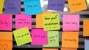 Post-it de las resoluciones del Año Nuevo Foto de archivo libre de regalías
