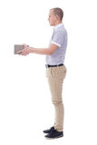 Post delivery service concept - full length side view of young m Royalty Free Stock Photo