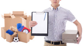 Post delivery service man holding blank clipboard and cardboard Stock Photography