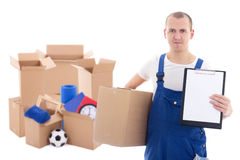 Post delivery service man in uniform holding blank clipboard and Royalty Free Stock Photos