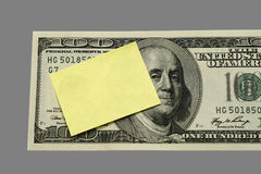 Post-it on Dollar Concept. For memo notice or message with money as subject Royalty Free Stock Image