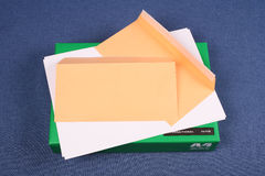 Post envelope on pack of  white paper Royalty Free Stock Images