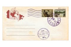 Fly to Canada. Memories. Post envelope with postage stamps and prints of Canada animals and nature landscapes. National parks. Canadian nature wild life protect Royalty Free Stock Photography