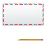 Post envelope and yellow pencil isolated on white background. Stock Photos