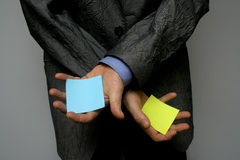 Post-it in hands. Man who is showing ore hiding a sign or message Stock Photo