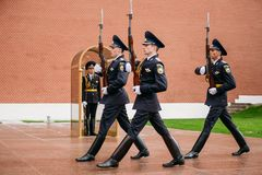 Post honor guard at the Eternal Flame in Moscow at the Tomb of the Unknown Soldier Post number 1 in the Alexander Garden. Moscow, Russia - May 24, 2015: Post stock photography