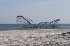 Post Hurricane Sandy. A roller coaster sits in the Atlantic Ocean after Superstorm Sandy destroyed the pier upon which is sat Royalty Free Stock Photo
