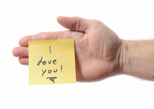 Post it i love you. Post it note on hand saying i love you Royalty Free Stock Image