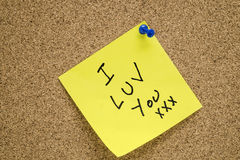 Post it I LUV YOU. A post it love note that says I Luv You in on a cork board Stock Photos