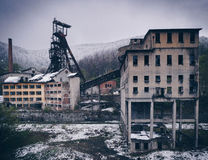 Post industrial landscape of the abandoned mining facility in An. Ina, Romania in winter time (snowing stock illustration