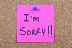 Post-Itanmerkung mit es tut mir leid Lizenzfreie Stockfotos