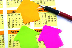 Post its. Post it and pen on a calendar Royalty Free Stock Images
