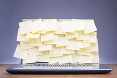 Post-its attached to laptop Royalty Free Stock Photos