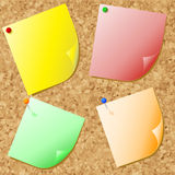 Post-its on cork. Different coloured post-it notes on cork noticeboard Royalty Free Stock Photos