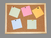Post-its on cork board Stock Photo