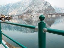 Post at lake mountain winter season snow landscape village hallstatt stock photos