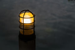 The post lamp with blurred water background Stock Photography