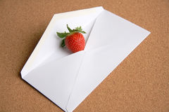 Post a love heart to dearest person. Stawberry as a heart shape ,put it into a envelope then post to dearest person Royalty Free Stock Image